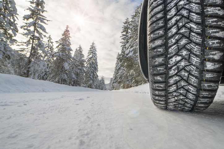 car with winter tires on snowy road