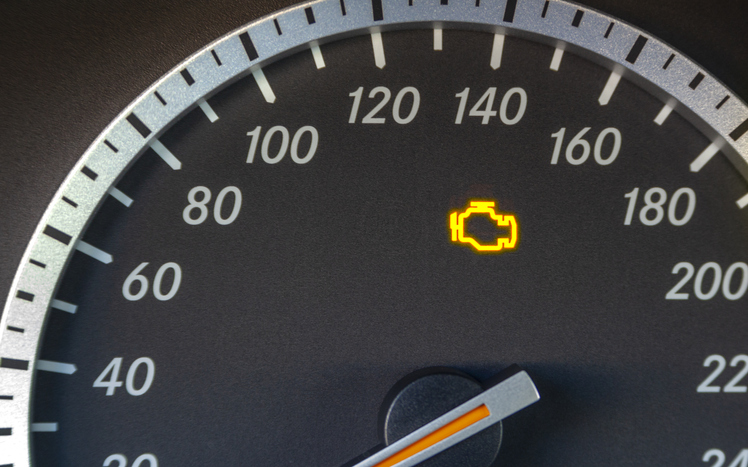 Engine failure symbol lights up in the dashboard of the car